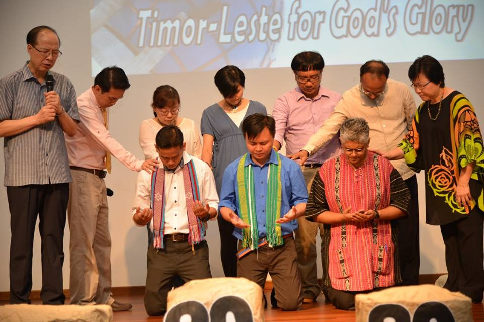 Bro. Ung-Seop Shin praying over the K.O.W team Photo Credit: FES Malaysia