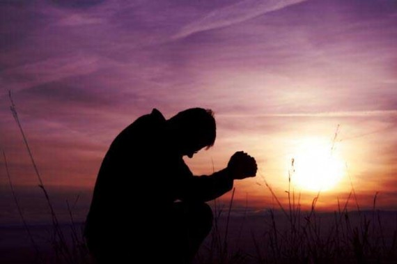 man-praying-570x379