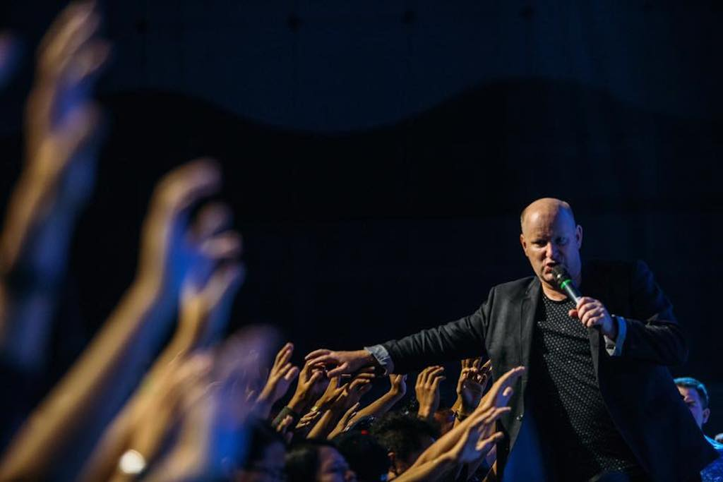 Pastor Russell Evans reaching out to the people in Awakening Malaysia 2016