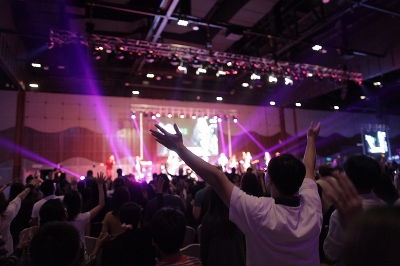 The attendees of Jesus Festival worshipping God