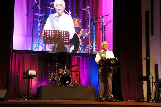 Rev Dr Henry Pillai, Senior Pastor of Grace Assembly giving a message