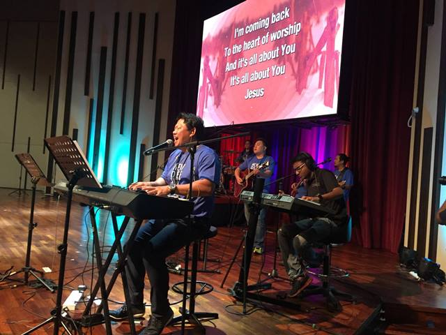 Patrick Leong from Grace Assembly leading in worship.