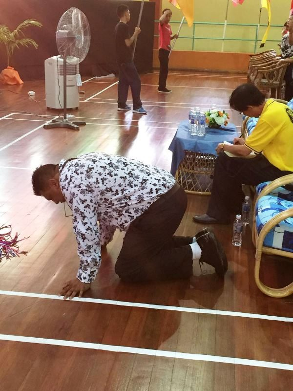 Pastor Suleman Manzoor kneeling before God