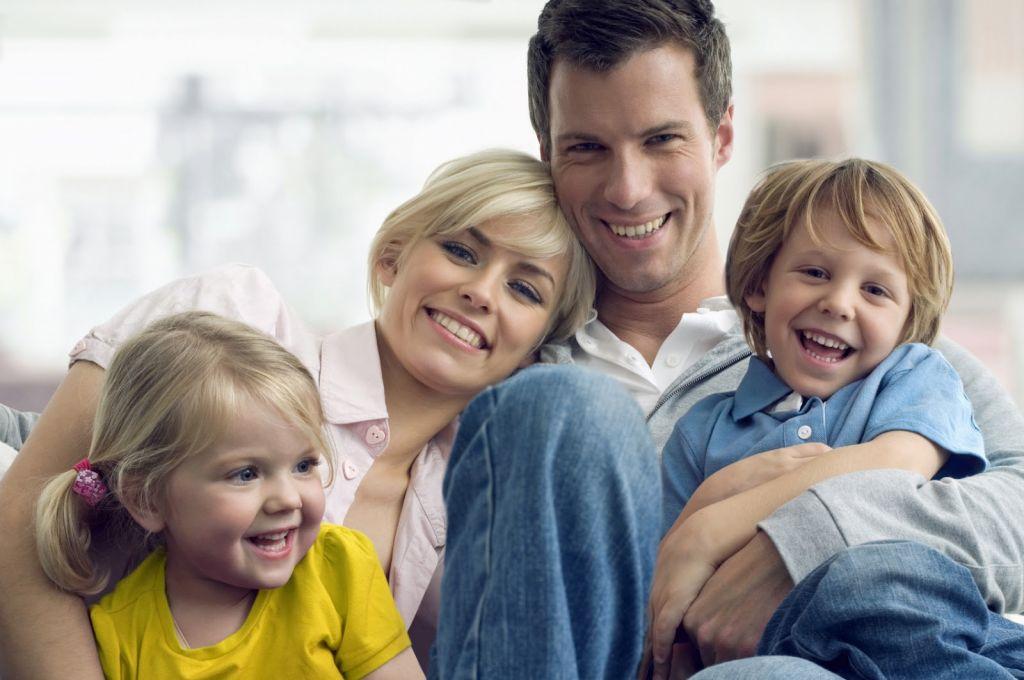 family happy kids couch iStock_000008092663Medium