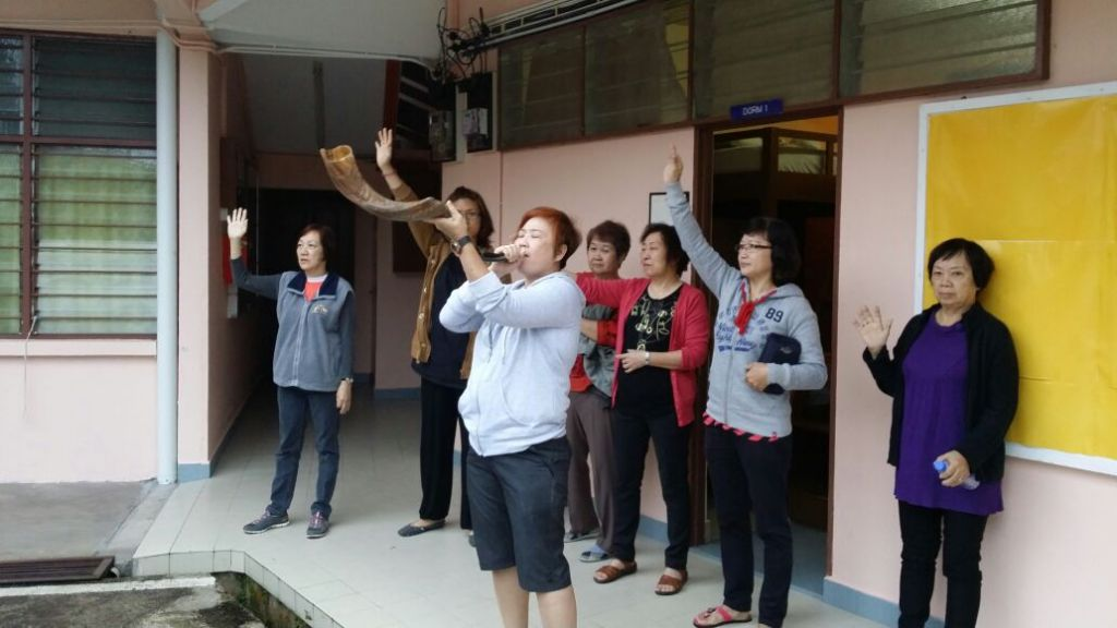 Sarah Lim (front) today, blowing the shofar, proclaiming the glory of God