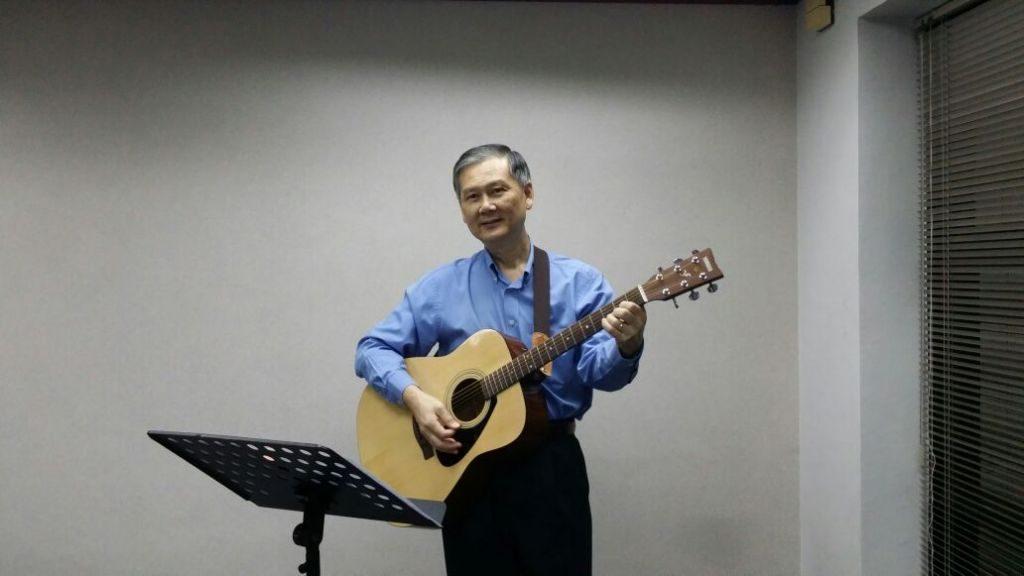 Pastor Nick Nip leading worship