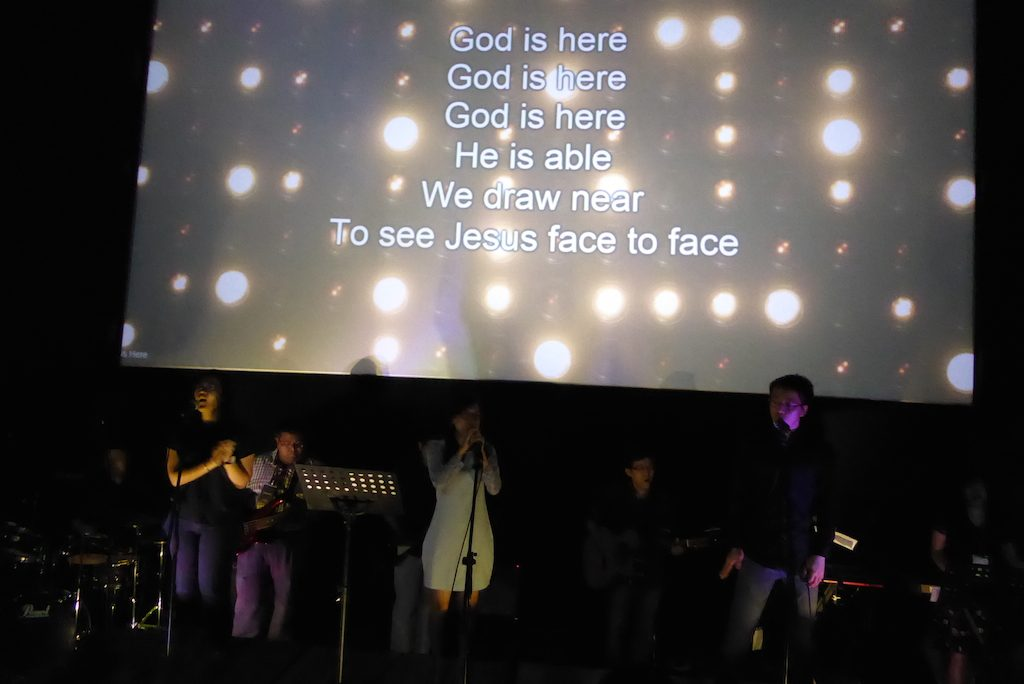 The worship band of Victory Church leading worship before the Alpha Film Series