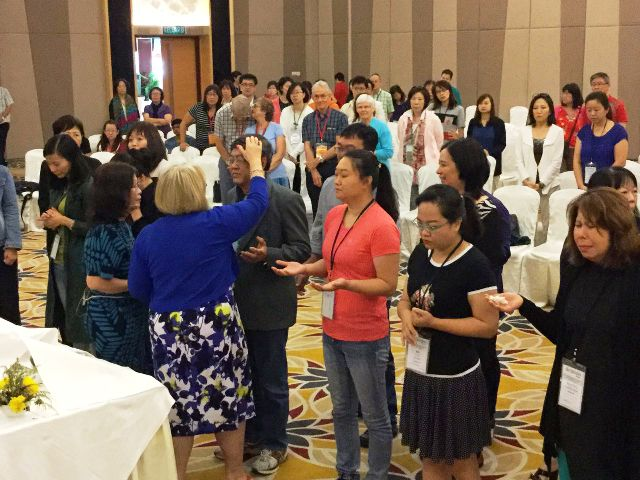 Jill Southern praying for the participants in the 2016 7-day Ellel Conference in Putrajaya