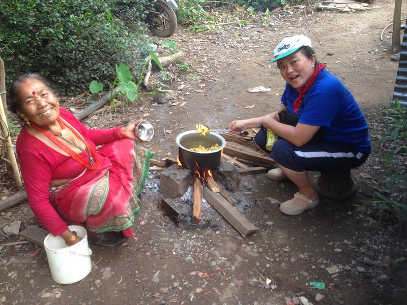 Elina learning to cook dal bhat in a village ministry at Nepal