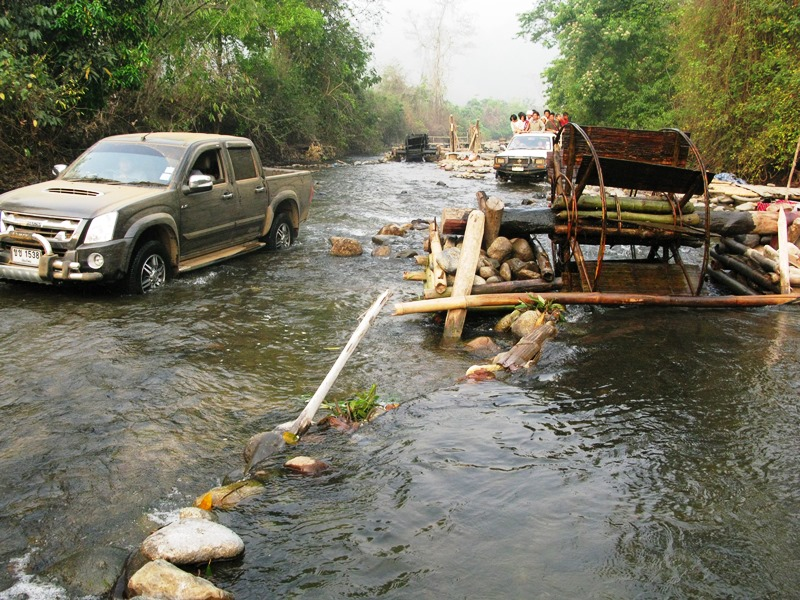 Missionaries crossing rivers to reach the inner villages of Thailand