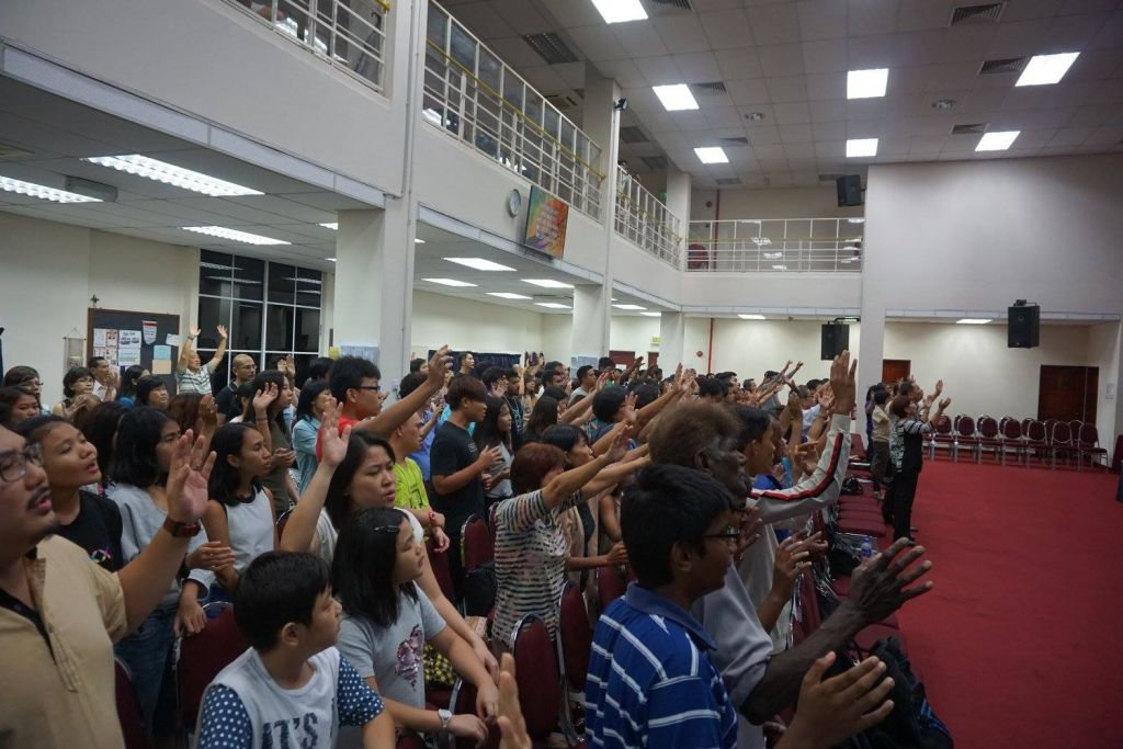 Attendees of FGA Taiping and young adults of the Exponential Camp worshipping God together at FGA Taiping