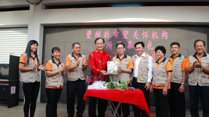 New Hope Center opening ceremony by Reverend Liew Kek Ming (5th from right)