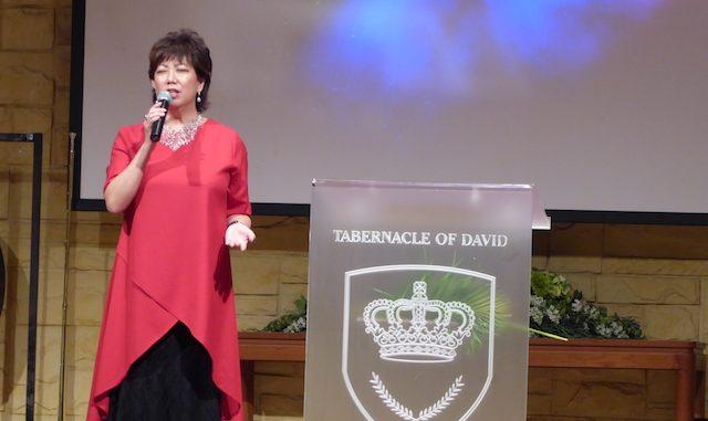 Pastor Irene Chong praying for the congregation